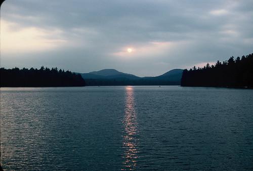 sunset lake newyork clouds forest adirondacks hills 1957 kodachrome rollinspond unescomabbiospherereserve
