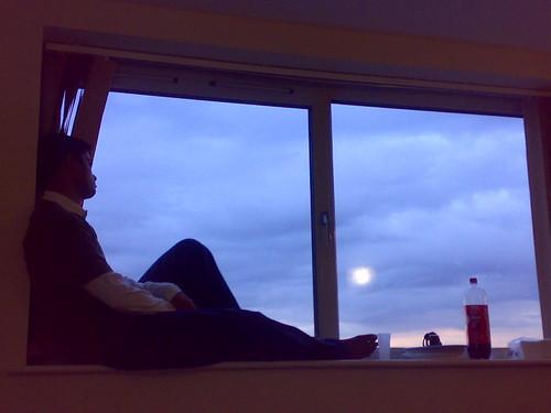 I sit beside the window..