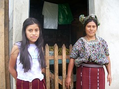Maria Tipaz Ramirez and daughter in front of their little store