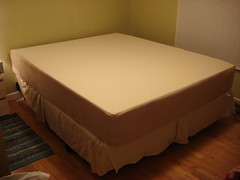 bed frame(0.0), studio couch(0.0), floor(1.0), furniture(1.0), wood(1.0), room(1.0), box-spring(1.0), bed sheet(1.0), bed(1.0), mattress(1.0),