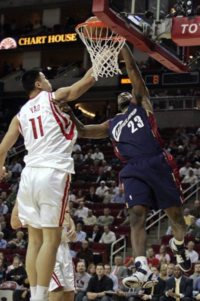 Yao Ming blocks a dunk attempt by LeBron James on Thursday ...