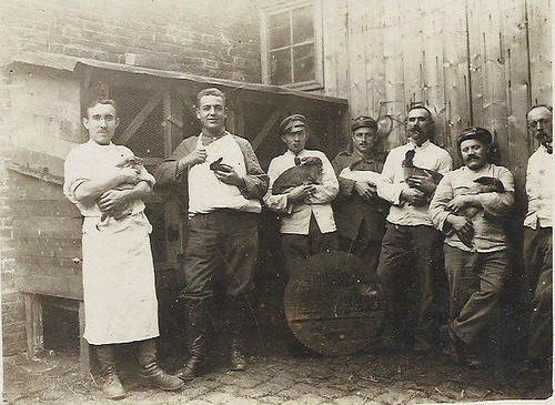German Men Holding Bunnies