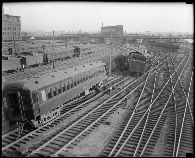 Locomotive and train jumps track. South Station near signal bridge no. 6