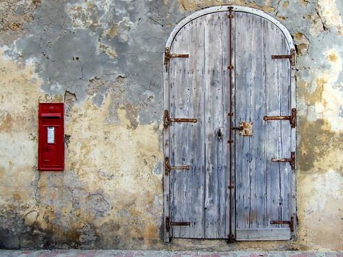 door blue red building wall decay malta victoria plaster letterbox peelingpaint flaking gozo flakingplaster