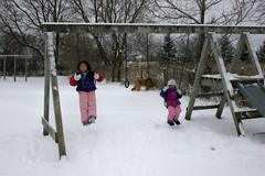 Girls on the Swingset in the Snow