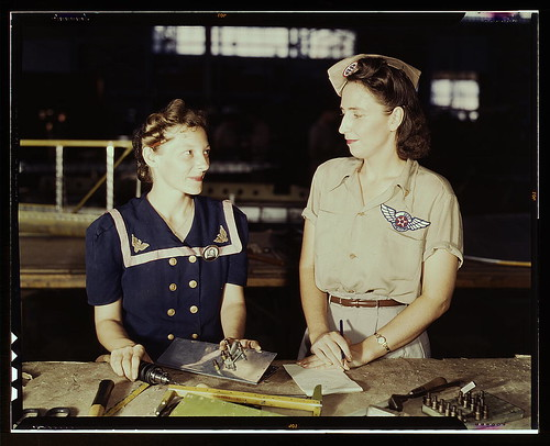 Pearl Harbor widows have gone into war work to carry on the fight with a personal vengeance, Corpus Christi, Texas. Mrs. Virginia Young (right) whose husband was one of the first casualties of World War II, is a supervisor in the Assembly and Repairs Depa