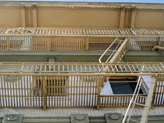 outdoor structure(0.0), stall(0.0), roof(0.0), cage(0.0), deck(0.0), baluster(1.0), wood(1.0), handrail(1.0), iron(1.0), balcony(1.0),