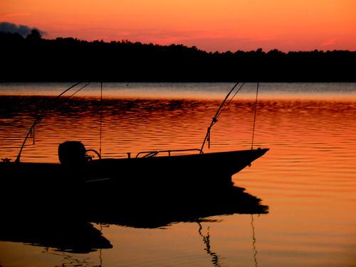 sunset orange lake fish color reflection water silhouette docks landscape boats evening nc glow bright ripple north vivid northcarolina raleigh line carolina rowboat lakecrabtree crabtree chrysti theexhibit platinumphoto aplusphoto platinumsuperstar