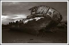 sketch(0.0), ship(0.0), iron(0.0), vehicle(1.0), monochrome photography(1.0), watercraft(1.0), shipwreck(1.0), monochrome(1.0), black-and-white(1.0),
