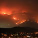 Mt. San Miguel on fire and raging toward homes in the Harris Fire of 2007.  San Diego wildfires. by slworking2
