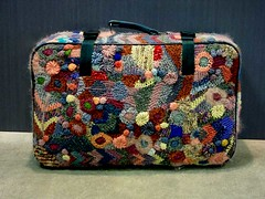 suitcase covered with freeform knitting and crochet
