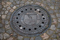 symmetry, cobblestone, manhole, manhole cover, circle, road surface,