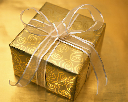 Gift box wrapped in gold paper