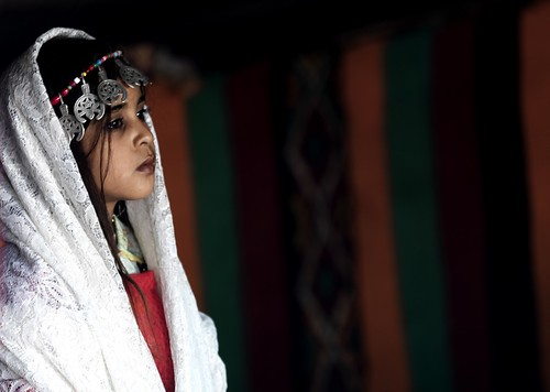 Veiled Tuareg girl under a tent, Ghadames, Libya