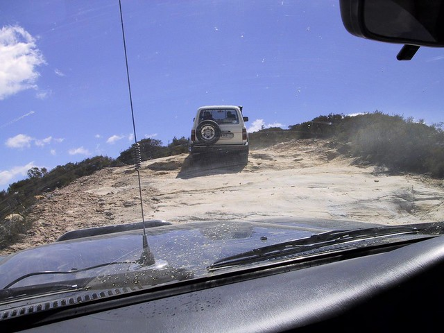 How to go up a dusty slick track