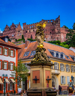 Heidelberg Castle and Madonna and Child Water Fountain in Altstatd Heidelberg Germany