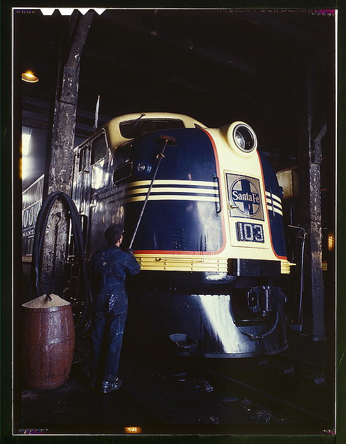 Washing one of the Santa Fe R.R. 54 hundred horse power diesel freight locomotives in the roundhouse, Argentine, Kansas. Argentine yard is at Kansas City, Kansas (LOC)