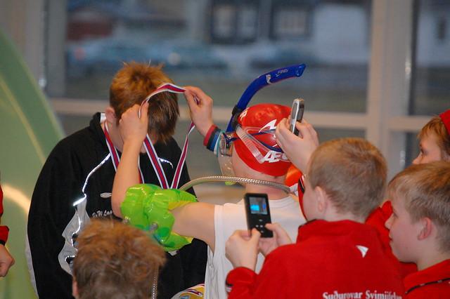 Overdressed medal presenter at a swim meet in Klaksvík