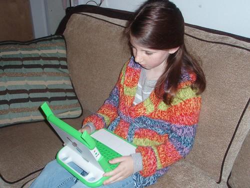 Girl playing on XO computer