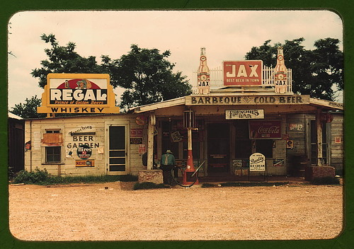 "A cross roads store, bar, ""juke joint,"" and gas station in the cotton plantation area, Melrose, La.  (LOC)"