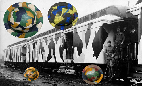 Camouflage painted railroad cars and helmets 1919
