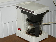 cup(0.0), coffee(0.0), drip coffee maker(1.0), espresso(1.0), coffeemaker(1.0), drink(1.0), espresso machine(1.0), small appliance(1.0),