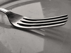 automotive exterior(0.0), wheel(0.0), wing(0.0), white(0.0), glass(0.0), bumper(0.0), drawing(0.0), iron(0.0), dishware(1.0), fork(1.0), tableware(1.0), monochrome photography(1.0), silver(1.0), cutlery(1.0), monochrome(1.0), black-and-white(1.0), black(1.0),