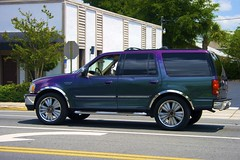 lincoln navigator(0.0), automobile(1.0), automotive exterior(1.0), sport utility vehicle(1.0), wheel(1.0), vehicle(1.0), compact sport utility vehicle(1.0), rim(1.0), ford expedition(1.0), bumper(1.0), land vehicle(1.0), luxury vehicle(1.0),