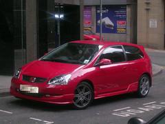 toyota(0.0), toyota corolla e120(0.0), honda civic type r(0.0), sedan(0.0), automobile(1.0), automotive exterior(1.0), wheel(1.0), vehicle(1.0), honda(1.0), compact car(1.0), bumper(1.0), land vehicle(1.0), hatchback(1.0),