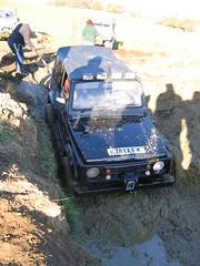 auto racing(0.0), military vehicle(0.0), dirt track racing(0.0), off road racing(0.0), city car(0.0), automobile(1.0), rallying(1.0), racing(1.0), sport utility vehicle(1.0), vehicle(1.0), motorsport(1.0), off-roading(1.0), rally raid(1.0), off-road vehicle(1.0), mud(1.0), land vehicle(1.0),