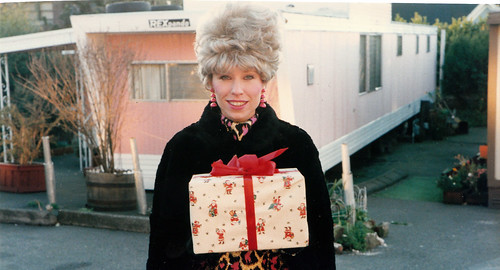 Christmas in a Mobile home - Lady with gift in mobile home park