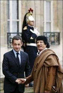 French President Sarkozy and Libyan leader Mummar Gadaffi during the North African head of state's visit to Paris. A deal was sealed involving arms and nuclear energy. France later bombed the country and sent military advisors for regime change. by Pan-African News Wire File Photos