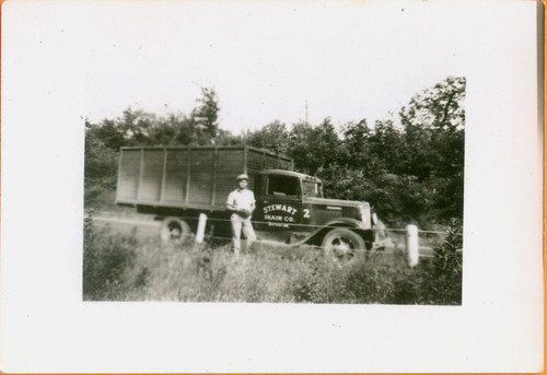 """Stewart Grain Co."" A man and his truck 01"