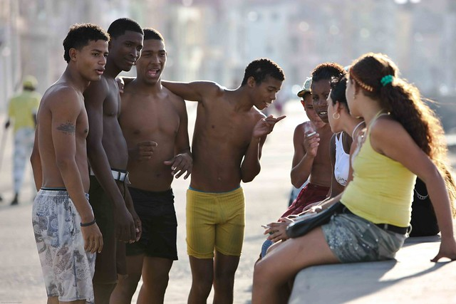 guys talking to the ladies at malecon in havanna, cuba