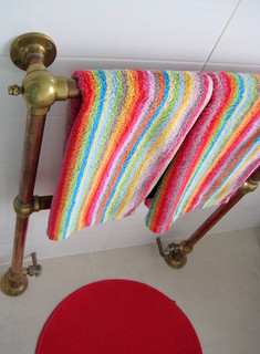 Splash of colour and vintage brass radiator / towel rail