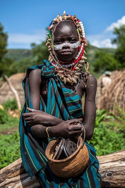 little boy with his face painted and shell necklace around the neck of the Mursi tribe, Lower Omo Valley-Ethiopia.