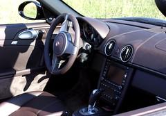 automotive exterior(0.0), automobile(1.0), wheel(1.0), vehicle(1.0), automotive design(1.0), porsche boxster(1.0), porsche(1.0), porsche cayman(1.0), steering wheel(1.0), land vehicle(1.0), luxury vehicle(1.0),