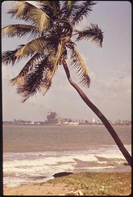 DOCUMERICA: Palo Seco Electric Power Plant in the Background San Juan, Puerto Rico 02/1973 by John Vachon (1914-1975).