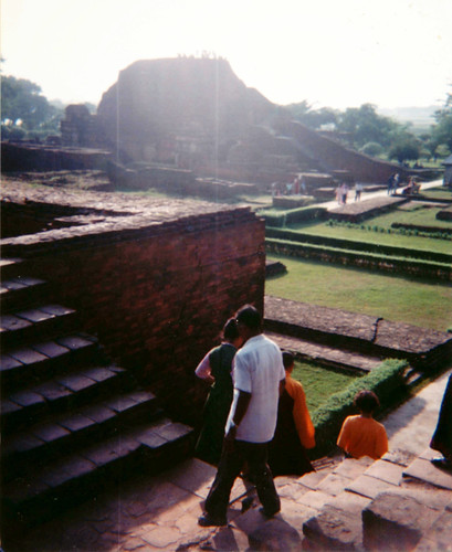 People walking through the famed huge Buddhist Nalanda University & Monastery ruins, brick stupas, ransacked & destroyed by Turkic Muslim invaders in 1193, Bihar, India, 1993 by Wonderlane