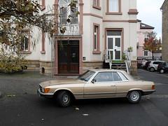 performance car(0.0), sedan(0.0), sports car(0.0), automobile(1.0), automotive exterior(1.0), wheel(1.0), vehicle(1.0), mercedes-benz r107 and c107(1.0), mercedes-benz(1.0), antique car(1.0), classic car(1.0), vintage car(1.0), land vehicle(1.0), luxury vehicle(1.0),