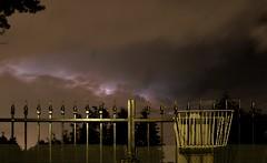 Photograph: Fence, basket and lightning