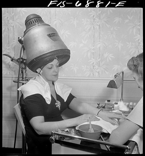 New York, New York. Getting a manicure while drying hair at Francois de Paris, a hairdresser on Eighth Street (LOC)