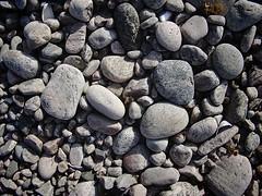 asphalt(0.0), boulder(0.0), stone wall(0.0), soil(0.0), stream bed(0.0), rubble(1.0), cobblestone(1.0), pebble(1.0), rock(1.0), gravel(1.0),