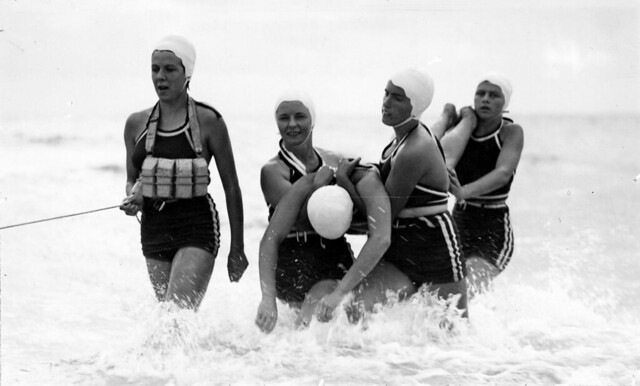 Women surf lifesavers in action at Brighton beach