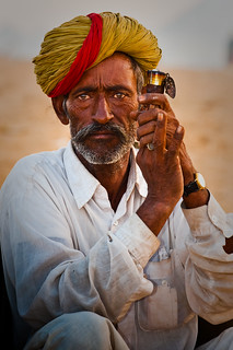 Man w/pipe: Pushkar Camel Fair 2009 (Inida)_
