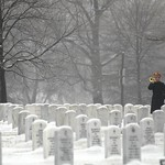 Taps is played on the bugle in the winter snow at Arlington National Cemetery