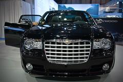 automobile(1.0), automotive exterior(1.0), exhibition(1.0), vehicle(1.0), automotive design(1.0), auto show(1.0), grille(1.0), chrysler 300(1.0), chrysler(1.0), bumper(1.0), land vehicle(1.0), luxury vehicle(1.0),