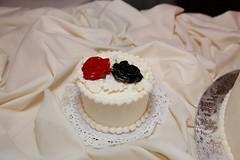 icing(0.0), wedding cake(0.0), wedding ceremony supply(1.0), cake(1.0), flower(1.0), buttercream(1.0), white(1.0), baked goods(1.0), whipped cream(1.0), sugar paste(1.0), food(1.0), cake decorating(1.0), torte(1.0),
