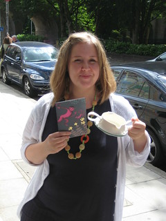 Cathy with her bargains of the day, card by Lush and ceramic gravy boat by Louisa Taylor