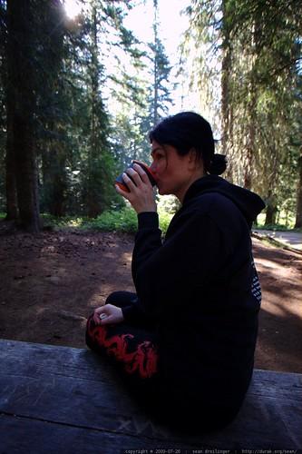 rachel having her morning tea on the picnic table    MG 9886